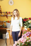 Florist. Portrait of florist standing in her shop. Small business royalty free stock images