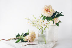 Florist preparation of a selection of vases scissors and string Stock Image