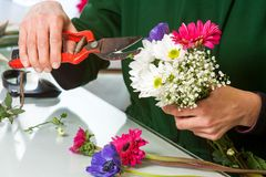 Florist pruning flower bouquet. Stock Images
