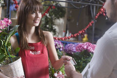 Florist Receiving Credit Card From Customer Stock Photo