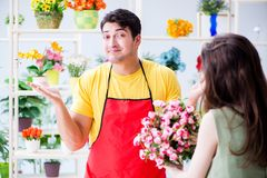 The florist selling flowers in a flower shop Stock Image