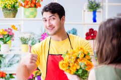 The florist selling flowers in a flower shop Stock Photos