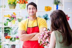 The florist selling flowers in a flower shop Stock Photography