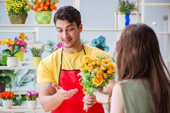 The florist selling flowers in a flower shop Stock Images
