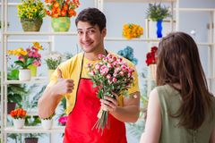 The florist selling flowers in a flower shop Stock Photo