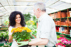 Florist selling flowers to a customer Royalty Free Stock Photography