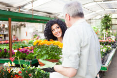 Florist selling flowers to a customer Royalty Free Stock Image