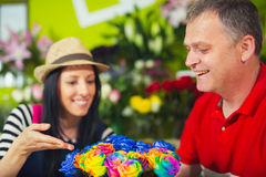 Florist serves male customer in buying flowers at store. Royalty Free Stock Photo