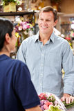 Florist serving customer Stock Image