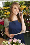 Florist In Shop Taking Phone Order For Delivery Royalty Free Stock Images