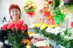 Florist in  small  flower shop Stock Image