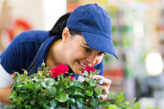 Florist smelling flower Royalty Free Stock Images