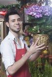 Florist Smiling While Holding Hydrangea Plant Stock Photo