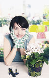 Florist smiling. Portrait of a young caucasian woman florist smiling Stock Photo