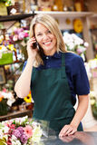 Florist standing at counter Stock Photos