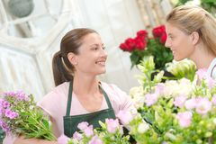 Florist stood with customer Royalty Free Stock Photo