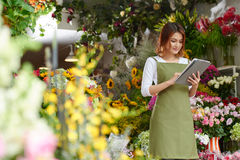 Florist with tablet Royalty Free Stock Images