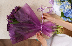 Florist tying the ribbon on  bouquet Stock Images