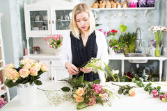 Florist with the variety of details for the floral composition Stock Photos
