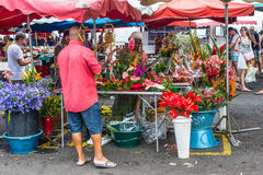 Florist and vendor on a local market Royalty Free Stock Image