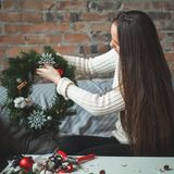 Florist Woman with Christmas Deco at Home Office. Desk Royalty Free Stock Images