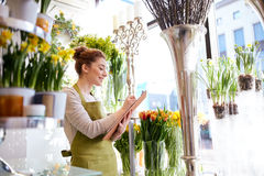 Florist woman with clipboard at flower shop Stock Images
