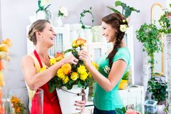 Florist woman and customer in flower shop Stock Photo