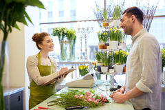 Florist woman and man making order at flower shop Stock Photo