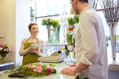 Florist woman and man making order at flower shop Royalty Free Stock Images