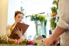 Florist woman and man making order at flower shop Stock Image