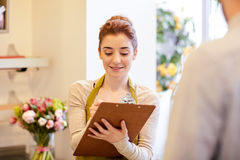 Florist woman and man making order at flower shop Royalty Free Stock Photo
