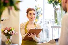 Florist woman and man making order at flower shop Stock Images