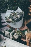 Florist woman ownership. Small business concept with florist woman ownership on modern flower shop Stock Photography