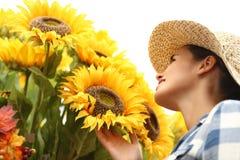 Florist woman touching sunflowers, summer concept Stock Photo
