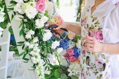 Florist woman at work Stock Photo
