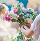 Florist woman at work Stock Photos