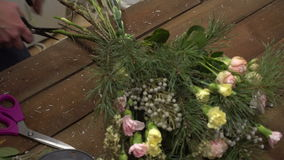 Florist at work with bouquet of flowers stock video footage