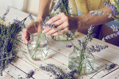 Florist at work: Creating small bouquets of natural lavender flo Stock Photo