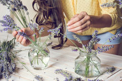 Florist at work: Creating small bouquets of natural lavender flo Royalty Free Stock Images