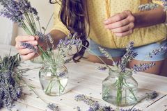 Florist at work: Creating small bouquets of natural lavender flo Stock Photos