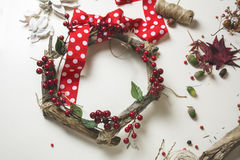 Florist at work: Creating a wooden wreath with christmas  red barries Stock Image