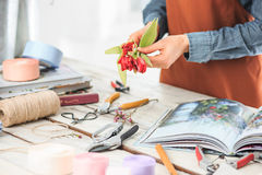 Florist at work: the female hands of woman making fashion modern bouquet of different flowers Royalty Free Stock Photography