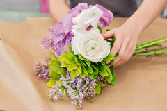 Florist work with flowers Royalty Free Stock Images