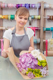 Florist work with flowers Stock Photography