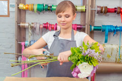 Florist work with flowers Stock Images