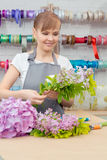 Florist work with flowers Stock Photo