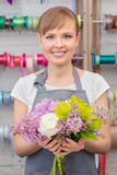 Florist work with flowers Royalty Free Stock Photo