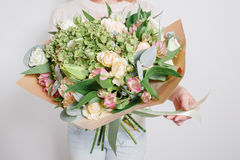 Florist at work. Make hydrangea rich bouquet. colorful roses, Stock Photography