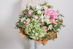 Florist at work. Make hydrangea rich bouquet. colorful roses, Royalty Free Stock Image