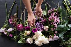 Florist at work. Florist make natural  flower composition Stock Photo